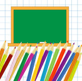 Bright colored pencils  and blackboard Royalty Free Stock Images