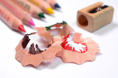 Bright colored pencils and color wood shavings Royalty Free Stock Photo