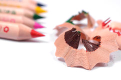 Bright colored pencils and color wood shavings Stock Image