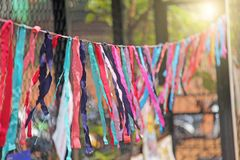 Bright colored ribbons hang and flutter in the wind. Fair holiday festival decoration. India, Goa, Arambol.  royalty free stock photo