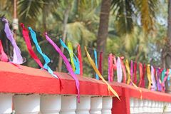Bright colored ribbons hang and flutter in the wind. Fair holiday festival decoration. India, Goa, Arambol.  royalty free stock images
