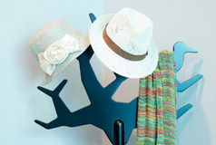 Bright colored scarf with hat hanging on a rack Stock Images