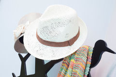 Bright colored scarf with hat hanging on a rack Royalty Free Stock Photography
