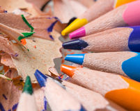 Bright colored set. Of 8 pencil among shavings Stock Photography