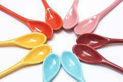 Bright colored spoons Stock Photos