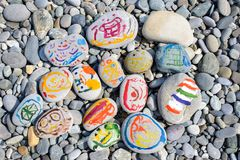 Bright colored stones on the beach stock photo