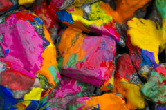Bright colored stones with paint. Abstract Background Bright Colored Stones With Paint, Bizarre to Spread Paint on the Surface Stock Photos