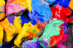Bright colored stones with paint. Abstract Background Bright Colored Stones With Paint, Bizarre to Spread Paint on the Surface Royalty Free Stock Image