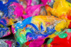 Bright colored stones with paint. Abstract Background Bright Colored Stones With Paint, Bizarre to Spread Paint on the Surface Stock Images