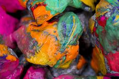 Bright colored stones with paint. Abstract Background Bright Colored Stones With Paint, Bizarre to Spread Paint on the Surface Stock Image