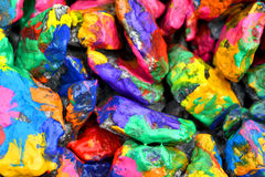 Bright colored stones with paint. Abstract Background Bright Colored Stones With Paint, Bizarre to Spread Paint on the Surface Stock Photography