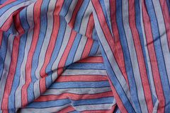 Bright colored striped texture of a cloth from a piece of crumpled clothes. Bright colored striped background of cloth from a piece of crumpled clothes Royalty Free Stock Photography