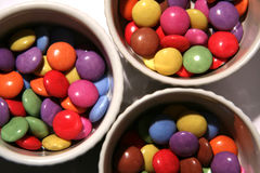 Bright colored sweets in bowls Royalty Free Stock Image