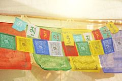 Bright colored Tibetan flags with mantras.  stock photo