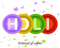 Bright colorful abstract circles of paint with Holi text.Lilac,y. Ellow,green, red design element.The spring Indian festival of colors.Purple and green spots Royalty Free Stock Photos