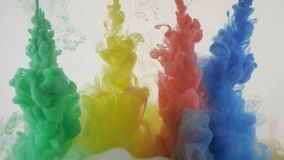 Bright colorful background. Vivid Liquid ink colors blending in water. Slow motion stock video footage