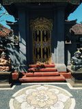 Bright colorful Balinese entrance with hindu sculptures sunny day Indonesia stock images