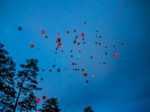 Bright colorful balloons fly into the evening sky in Altai royalty free stock image