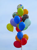 Bright colorful balloons over blue sky Stock Photo