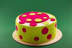 Bright colorful birthday cake with green and pink dots Stock Photography