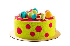 Colorful cake decorated with macaroons isolated on white Royalty Free Stock Photos