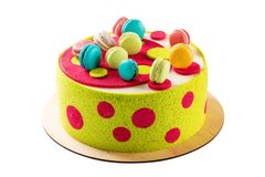 Colorful cake decorated with macaroons isolated on white Stock Photos