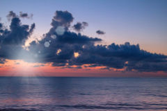 Bright colorful  blurred sunset over the sea Royalty Free Stock Photography