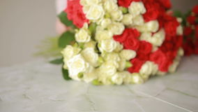 Bright colorful bouquet of red and white roses, florist woman gathers a bouquet stock footage