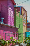 Bright Colorful Buildings of wood and plaster And Tropical Plants Stock Images
