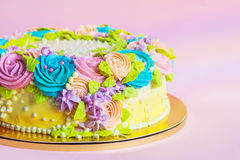 Bright colorful cake decorated with cream flowers Stock Photos