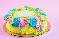 Bright colorful cake decorated with cream flowers Royalty Free Stock Photo