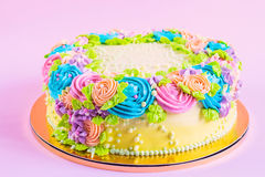 Bright colorful cake decorated with cream flowers Stock Images