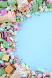 Bright colorful candy on pale blue wood table. Stock Images