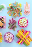 Bright Colorful Candy on Pale Bluw Wood Table. Stock Images