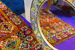 Bright colorful carpet and its reflection in mirror in Strasbourg , France Stock Image