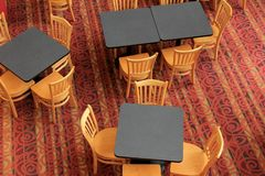 Bright and colorful carpeting with several chairs and tables for dining. Looking down on bright and colorful carpeting with arrangement of chairs and tables stock photos