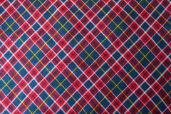 Bright colorful chequered fabric in red, blue and white Stock Image