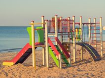 Bright and colorful children`s Playground on the ocean. Playground for children near the sea Stock Photo