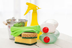 Bright colorful cleaning set on a wooden table Royalty Free Stock Photography