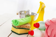 Bright colorful cleaning set on a wooden table Stock Images