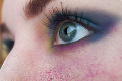 Bright colorful creative make-up on woman eye with powder on ski Royalty Free Stock Photos