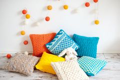 Bright colorful cushions. In the interior stock photo