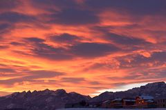 Bright colorful dawn over snowy mountains in winter day. stock image