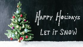 Bright Colorful Decorated Tree, Calligraphy Happy Holidays, Let It Snow. Black Cement Background With English Calligraphy Happy Holidays, Let It Snow. Bright royalty free stock image