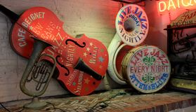 Colorful instruments on long shelf at historic Cafe Beignet, New Orleans, 2016. Bright and colorful detail in gaily painted musical instruments displayed on Stock Images