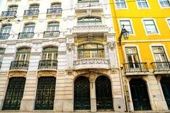 Bright colorful facade of old European building with windows . Bright colorful facade of old European building with windows stock images