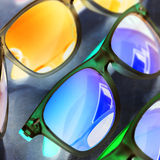 Bright colorful fashion mirror sunglasses close up on a negative filter close up still Royalty Free Stock Image