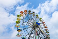 Colorful Ferris wheel against the blue sky. Royalty Free Stock Photo