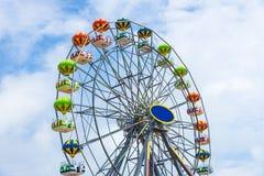 Colorful Ferris wheel against the blue sky. Stock Photos