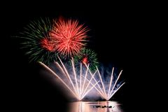 Bright and colorful fireworks against a black night sky.Firework Stock Photo